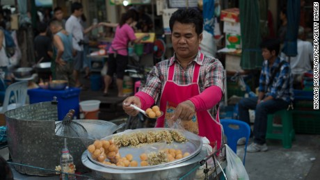 A street food vendor prepares take-away bags of food in the Thai capital Bangkok.