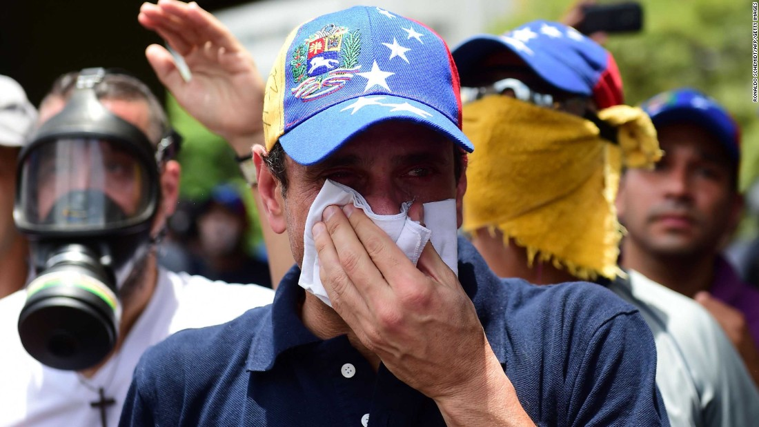 Opposition leader Henrique Capriles reacts to tear gas during the protest on April 19.