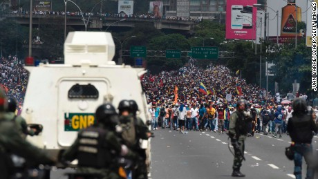Demonstrators are confronted by the riot police during a rally against Venezuelan President Nicolas Maduro, in Caracas on April 19, 2017.