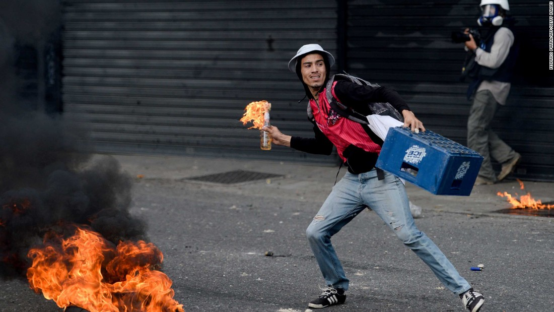 "A protester aims a Molotov cocktail at police on April 19. <a href=""http://edition.cnn.com/2017/04/18/americas/venezuela-protest-explainer/index.html"" target=""_blank"">Venezuela's political crisis has intensified</a> since the government notified main opposition leader Henrique Capriles on April 7 that he had been banned from political activity for 15 years. This came during protests denouncing the Supreme Court rulings issued on March 29, which curbed the powers of the opposition-controlled legislature."