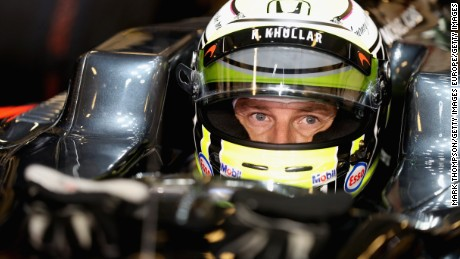 ABU DHABI, UNITED ARAB EMIRATES - NOVEMBER 27: Jenson Button of Great Britain and McLaren Honda in the garage before the Abu Dhabi Formula One Grand Prix at Yas Marina Circuit on November 27, 2016 in Abu Dhabi, United Arab Emirates.  (Photo by Mark Thompson/Getty Images)