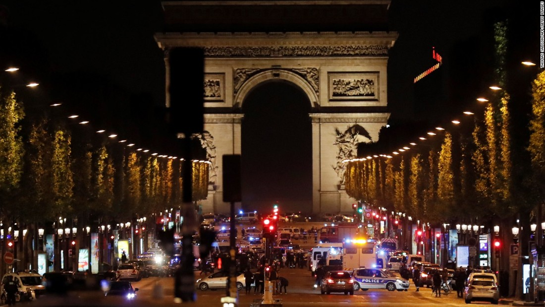 Champs Elysées in Paris closed, reports of 2 police officers shot.