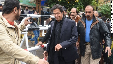 Pakistani opposition leader Imran Khan (center) leaves the Supreme Court in January.