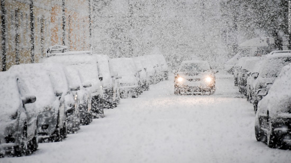 A car drives through snow in Munich, Germany, on Tuesday, April 18.
