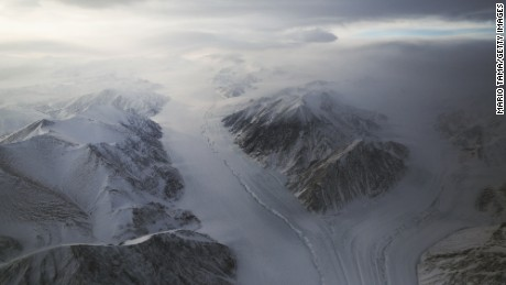 ELLESMERE ISLAND, CANADA - MARCH 29:  A section of a glacier is seen from NASA's Operation IceBridge research aircraft on March 29, 2017 above Ellesmere Island, Canada. The ice fields of Ellesmere Island are retreating due to warming temperatures. NASA's Operation IceBridge has been studying how polar ice has evolved over the past nine years and is currently flying a set of eight-hour research flights over ice sheets and the Arctic Ocean to monitor Arctic ice loss aboard a retrofitted 1966 Lockheed P-3 aircraft. According to NASA scientists and the National Snow and Ice Data Center (NSIDC), sea ice in the Arctic appears to have reached its lowest maximum wintertime extent ever recorded on March 7. Scientists have said the Arctic has been one of the regions hardest hit by climate change.  (Photo by Mario Tama/Getty Images)