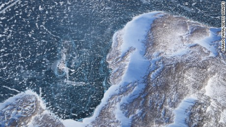IN FLIGHT, GREENLAND - MARCH 27:  Sea ice (TOP) meets land as seen from NASA's Operation IceBridge research aircraft along the Upper Baffin Bay coast on March 27, 2017 above Greenland. Greenland's ice sheet is retreating due to warming temperatures. NASA's Operation IceBridge has been studying how polar ice has evolved over the past nine years and is currently flying a set of eight-hour research flights over ice sheets and the Arctic Ocean to monitor Arctic ice loss aboard a retrofitted 1966 Lockheed P-3 aircraft. According to NASA scientists and the National Snow and Ice Data Center (NSIDC), sea ice in the Arctic appears to have reached its lowest maximum wintertime extent ever recorded on March 7. Scientists have said the Arctic has been one of the regions hardest hit by climate change.  (Photo by Mario Tama/Getty Images)
