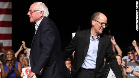 "MIAMI, FL - APRIL 19:  Sen. Bernie Sanders (I-VT) and DNC Chair Tom Perez walk past each other as Sen. Sanders takes to the stage to speak during their ""Come Together and Fight Back"" tour at the James L Knight Center on April 19, 2017 in Miami, Florida. Sanders and Perez spoke on topics from raising the minimum wage to $15 an hour, pay equity for women, rebuilding the crumbling infrastructure, combatting climate change, making public colleges and universities tuition-free, criminal justice reform, comprehensive immigration reform and tax reform which demands that the wealthy and large corporations start paying their fair share of taxes. (Photo by Joe Raedle/Getty Images)"