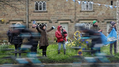 Spectators line the main street of Ripley as the riders of the Tour De Yorkshire cycle race pass through the village.