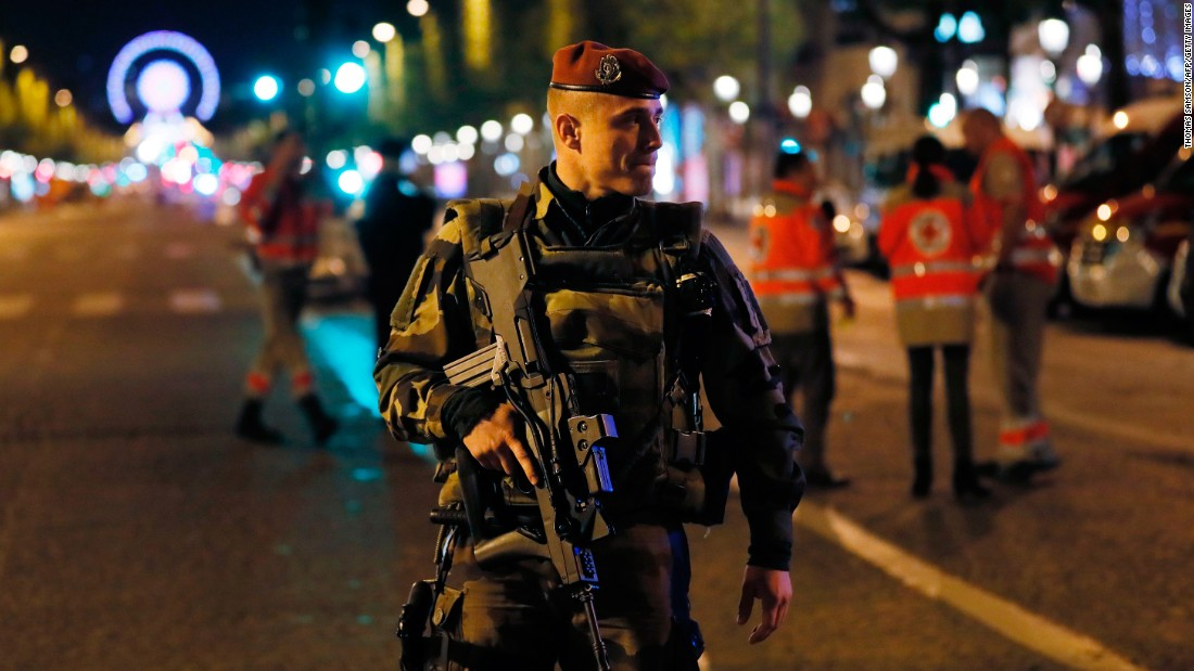 A French soldier stands guard after the shooting.