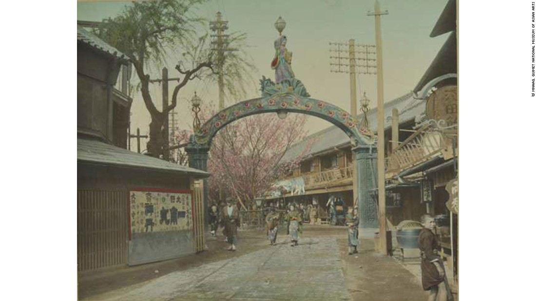 An old photo of the entrance to the pleasure quarter of Yoshiwara, Tokyo, where visitors could be entertained by courtesans, kabuki theater, restaurants and tea houses.