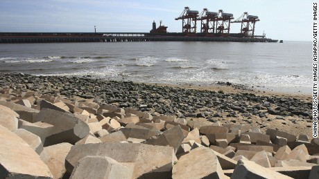 TANGSHAN, CHINA - JULY 19: (CHINA OUT) A view of a wharf at Caofeidian Port on July 19, 2006 in Tangshan of Hebei Province, China. Caofeidian Port will be developed as the biggest deep water port, coal transportation center and steel production base in northern China. July 28 will mark the 30th anniversary of Tangshan Earthquake. On July 28, 1976, the devastating magnitude 7.8 earthquake hit Tangshan, killing over 240,000 people and destroying 93 per cent of residential buildings, the disaster was the deadliest of the 20th century. In the 30 years, China has spent over 10 billion yuan (USD 1.25 billion) to rebuild the industrial city and Tangshan has entered China's top 20 cities in terms of overall strength, according to state media. (Photo by China Photos/Getty Images)