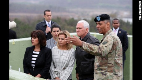 U.S. Vice President Mike Pence, center right, is briefed by U.S. Gen. Vincent Brooks, right, commander of the United Nations Command, U.S. Forces Korea and Combined Forces Command, right, as Pence's wife Karen, left, and his two daughters Charlotte, center left, and Audrey, second from left,  stand from Observation Post Ouellette in the Demilitarized Zone (DMZ), near the border village of Panmunjom, South Korea, Monday, April 17, 2017. His 10-day tour of Asia comes as tensions grow in the wake of North Korea's latest missile test. (AP Photo/Lee Jin-man)