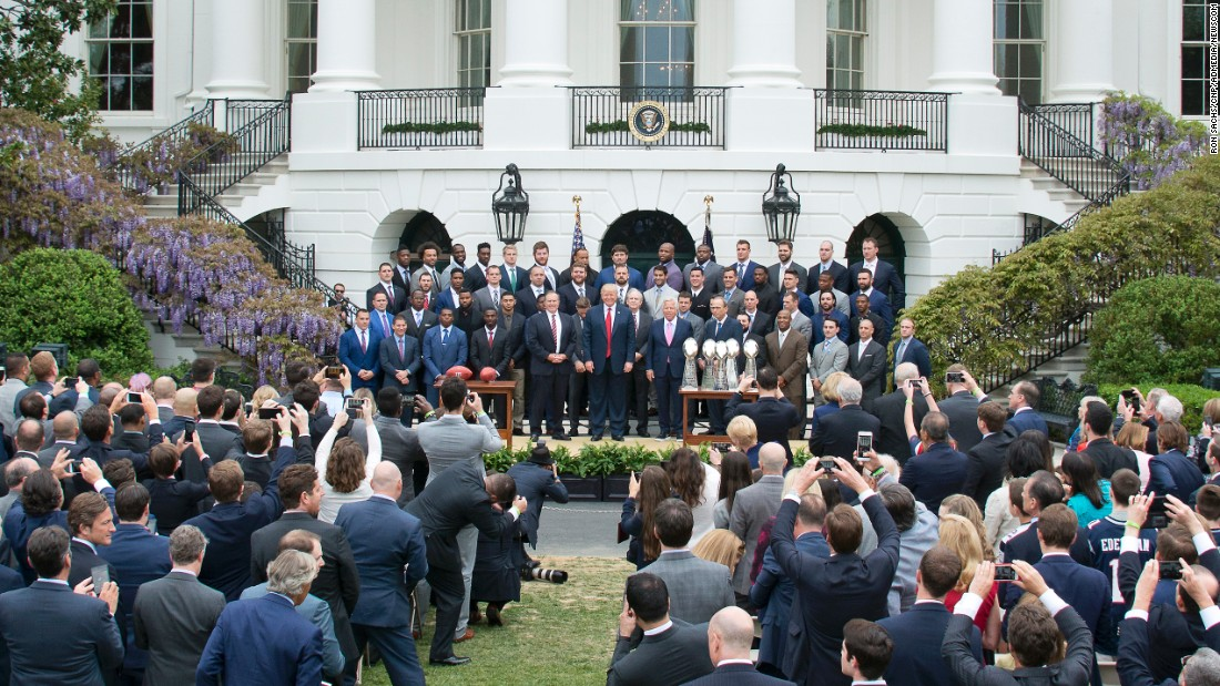 "President Trump <a href=""http://www.cnn.com/2017/04/20/politics/white-house-new-england-patriots/index.html"" target=""_blank"">poses for photographs</a> Wednesday, April 19, with the New England Patriots during a celebration of the team's Super Bowl victory on the South Lawn at the White House."