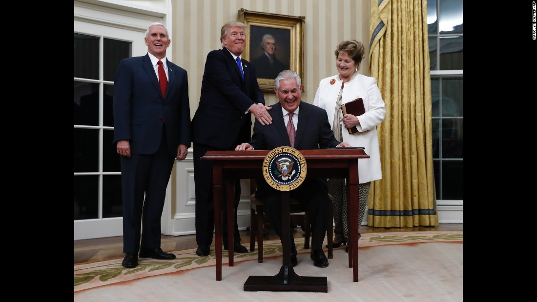 "Trump puts his hand on the shoulder of Secretary of State Rex Tillerson after <a href=""http://www.cnn.com/2017/02/01/politics/tillerson-confirmation-vote-senate/"" target=""_blank"">Tillerson was sworn in</a> on February 1. They are joined by Vice President Pence and Tillerson's wife, Renda St. Clair. Tillerson, a former CEO of ExxonMobil, was <a href=""http://www.cnn.com/2017/02/01/politics/tillerson-confirmation-vote-senate/"" target=""_blank"">confirmed in the Senate </a>by a vote of 56 to 43."