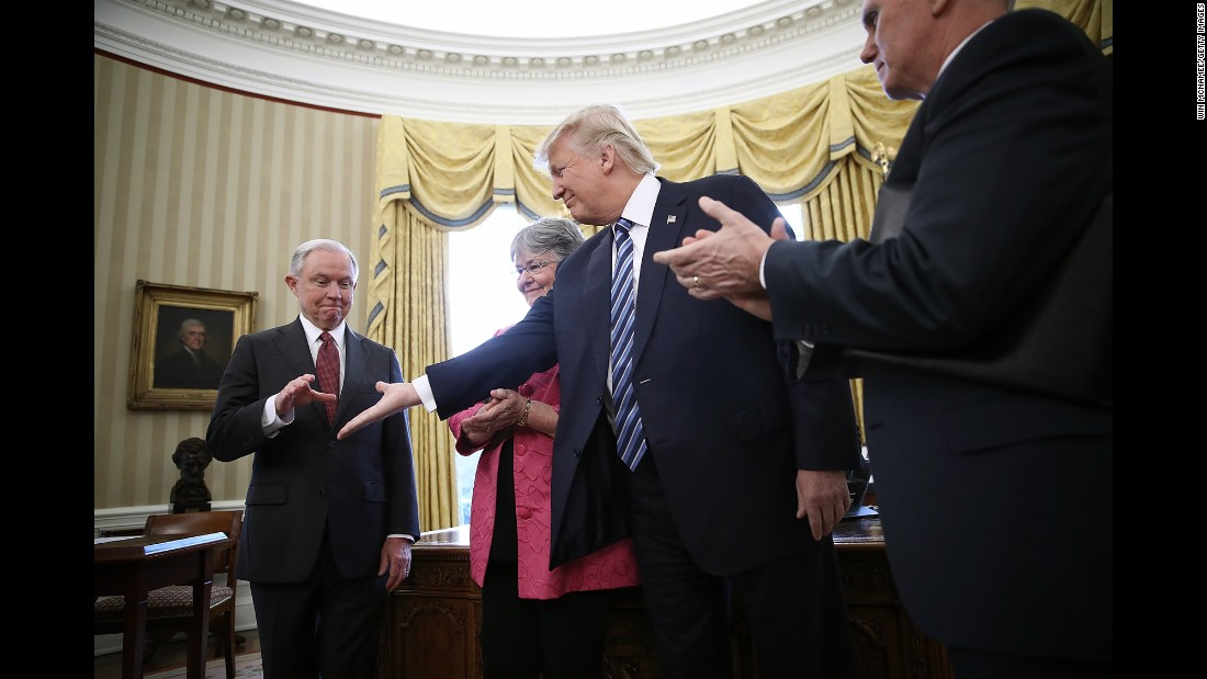 "Trump offers his hand to Jeff Sessions, who had just been sworn in as the new attorney general on February 9. Sessions, one of Trump's closest advisers and his earliest supporter in the US Senate, <a href=""http://www.cnn.com/2017/02/08/politics/jeff-sessions-vote-senate-slog/"" target=""_blank"">was confirmed by a 52-47 vote</a> that was mostly along party lines. He was accompanied to the swearing-in by his wife, Mary."