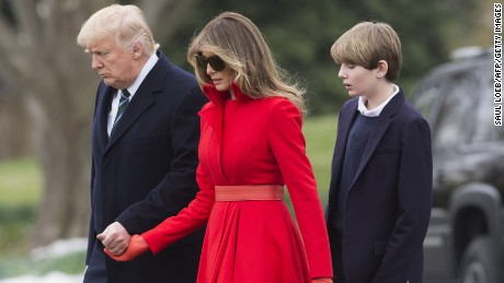 US President Donald Trump, First Lady Melania Trump and their son, Barron, walk to Marine One prior to departing from the South Lawn of the White House in Washington, DC, on March 17, 2017, as they travel for the weekend to West Palm Beach, Florida. / AFP PHOTO / SAUL LOEB        (Photo credit should read SAUL LOEB/AFP/Getty Images)