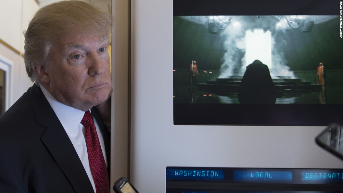 "Trump speaks to the press aboard Air Force One on April 6. The Internet <a href=""http://www.avclub.com/article/trump-stands-next-darth-vader-provoking-brief-mome-253358"" target=""_blank"">had some fun with the juxtaposition</a> of Trump and ""Star Wars"" villain Darth Vader, who appeared in the scene on the right from the film ""Rogue One."""