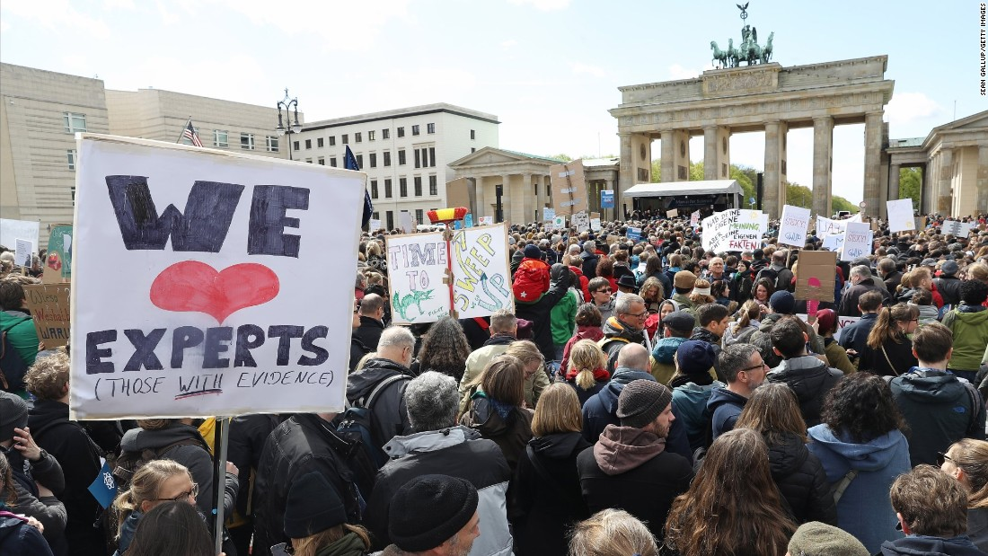 Marchers gathered in front of the Brandenburg Gate in Berlin. Similar marches drew people in more than 500 cities around the world.