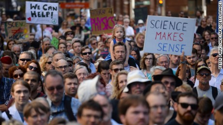 "Supporters of science and research gather for the March for Science protest in Sydney on April 22, 2017.  Thousands of people rallied in Australia and New Zealand on April 22 in support of science, the first of more than 500 marches globally triggered by concern over the rise of ""alternative facts"". / AFP PHOTO / Peter PARKS        (Photo credit should read PETER PARKS/AFP/Getty Images)"