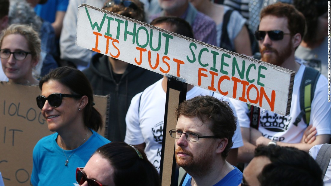 People stand together in Martin Place, in Sydney, Australia,for the city's international March for Science.