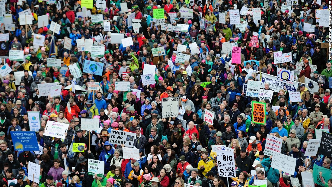Thousands of protesters fill Tom McCall Waterfront Park during the March for Science in Portland, Oregon, on Saturday, April 22. Protests were held in cities around the world against President Donald Trump's policies.