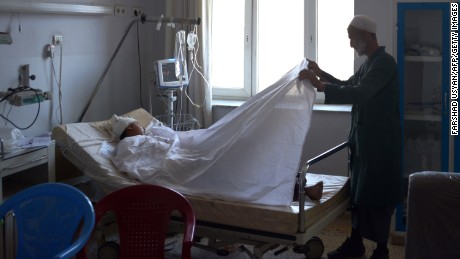 "A wounded Afghan National Army soldier lies on a bed in the ward of a hospital in Mazar-i-Sharif on April 22, as he receives treatment following an attack that targeted an army compound in the northern Afghan province of Balkh. More than 100 Afghan soldiers have been killed and wounded in a coordinated Taliban attack on an army base in northern Afghanistan, the country's defence ministry said. ""The majority of our soldiers were offering Friday prayers"" at the time of the assault, the ministry said in a statement, adding that ""over 100 Afghan army forces were martyred and wounded."""