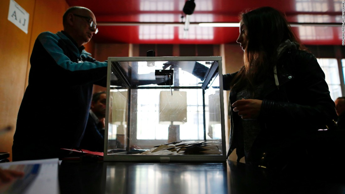 A woman casts her vote at a polling station in Paris.