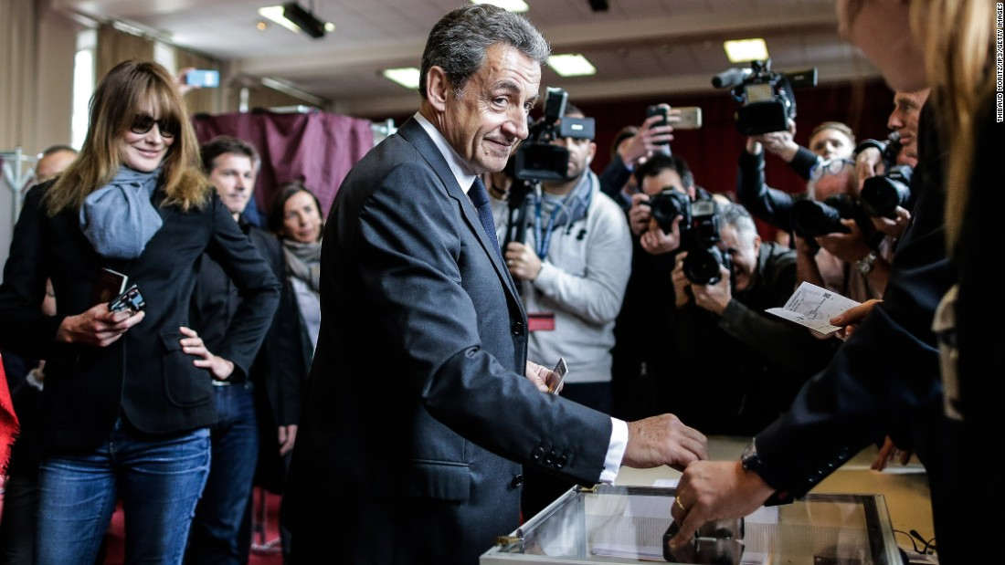 Former French president Nicolas Sarkozy and his wife, Carla Bruni Sarkozy, vote at a polling station in Paris.