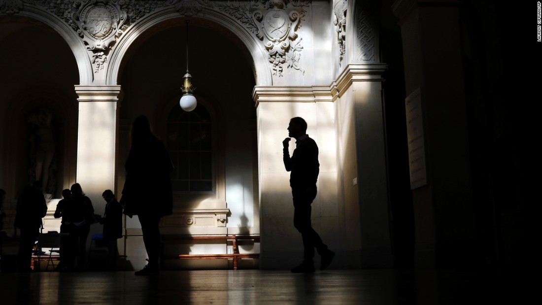 A voter waits to cast his ballot in Lyon.