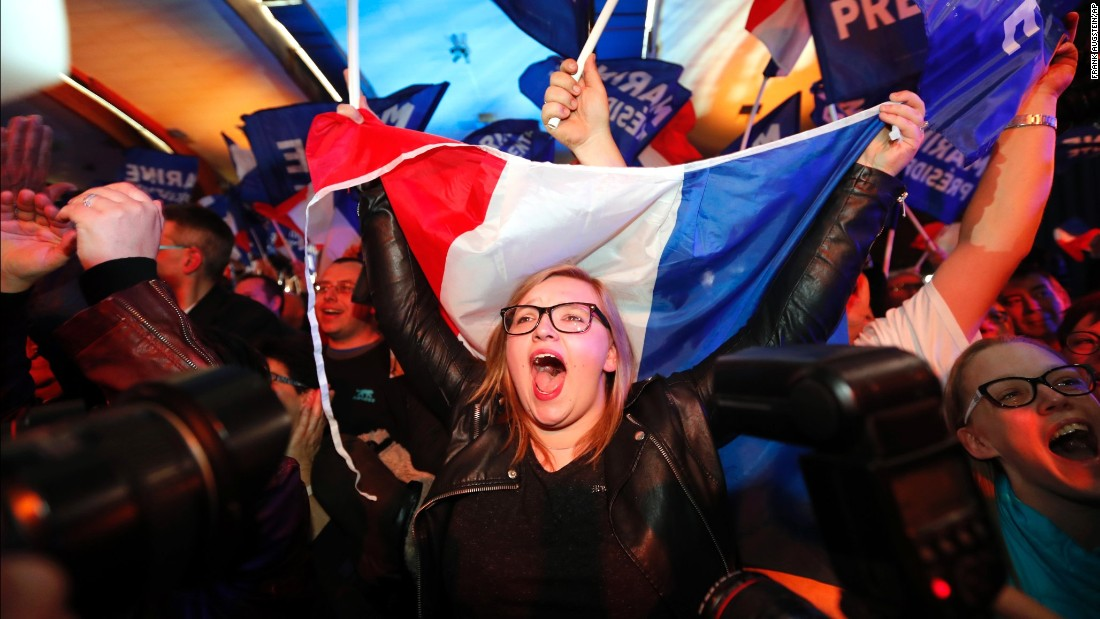 Le Pen supporters celebrate exit-poll results on April 23.