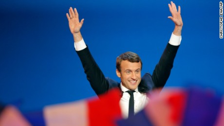 French centrist presidential candidate Emmanuel Macron waves before addressing his supporters at his election day headquarters in Paris , Sunday April 23, 2017. Macron and far-right populist Marine Le Pen advanced Sunday to a runoff in France's presidential election, remaking the country's political system and setting up a showdown over its participation in the European Union. (AP Photo/Christophe Ena)