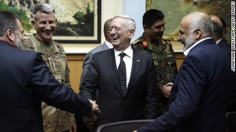 US Defense Secretary James Mattis (C) and US Army General John Nicholson (2nd L), the top US commander in Afghanistan, meet with Afghanistan's National Directorate of Security Director Mohammad Masoom Stanekzai (R) and other members of the Afghan delegation at Resolute Support headquarters in Kabul on April 24, 2017. US Defense Secretary Jim Mattis arrived in Afghanistan on an unannounced visit April 24, an American defence official confirmed, hours after his Afghan counterpart resigned over a deadly Taliban attack. Mattis, making his first visit to Afghanistan as Pentagon chief, was due to meet top officials including President Ashraf Ghani less than two weeks after the US dropped its largest non-nuclear bomb on Islamic State hideouts in the country's east.