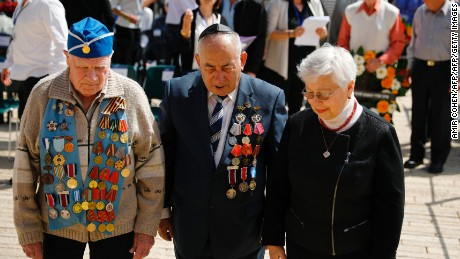 World War II veterans lay a wreath during a ceremony marking the annual Holocaust Remembrance Day at the Yad Vashem Holocaust Memorial in Jerusalem on April 24, 2017. Israelis stood silent and sirens rang out for two minutes as the country held its annual remembrance of the six million Jewish victims of the Holocaust. / AFP PHOTO / POOL / AMIR COHEN        (Photo credit should read AMIR COHEN/AFP/Getty Images)