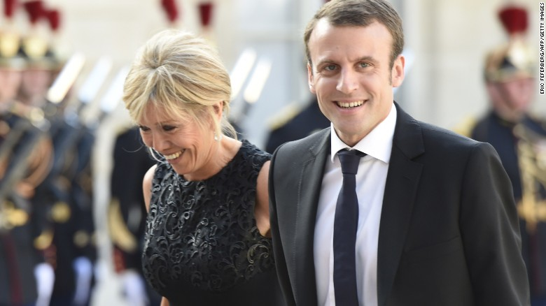 French Economy Minister Emmanuel Macron (R) and his wife Brigitte Trogneux arrive at the Elysee presidential palace in Paris to attend a state dinner as part of the three-day offical visit of the King and Queen of Spain, on June 2, 2015.  AFP PHOTO / ERIC FEFERBERG        (Photo credit should read ERIC FEFERBERG/AFP/Getty Images)