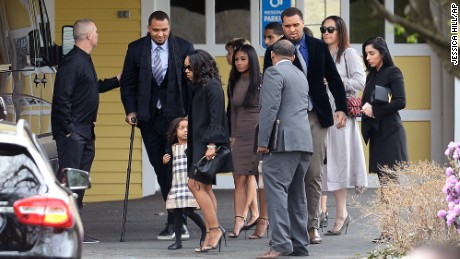 Shayanna Jenkins-Hernandez, fiancee of Aaron Hernandez, arrives with their daughter at funeral