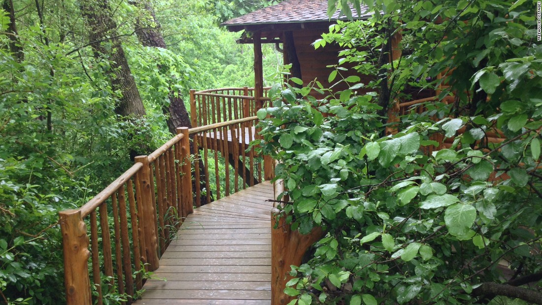 <strong>Treehouse Cottages, Eureka Springs, Arkansas:</strong> While three of these tree houses are located on a wooded hillside just minutes from downtown, four are actually within a 33-acre forest. (Jacuzzi included.)