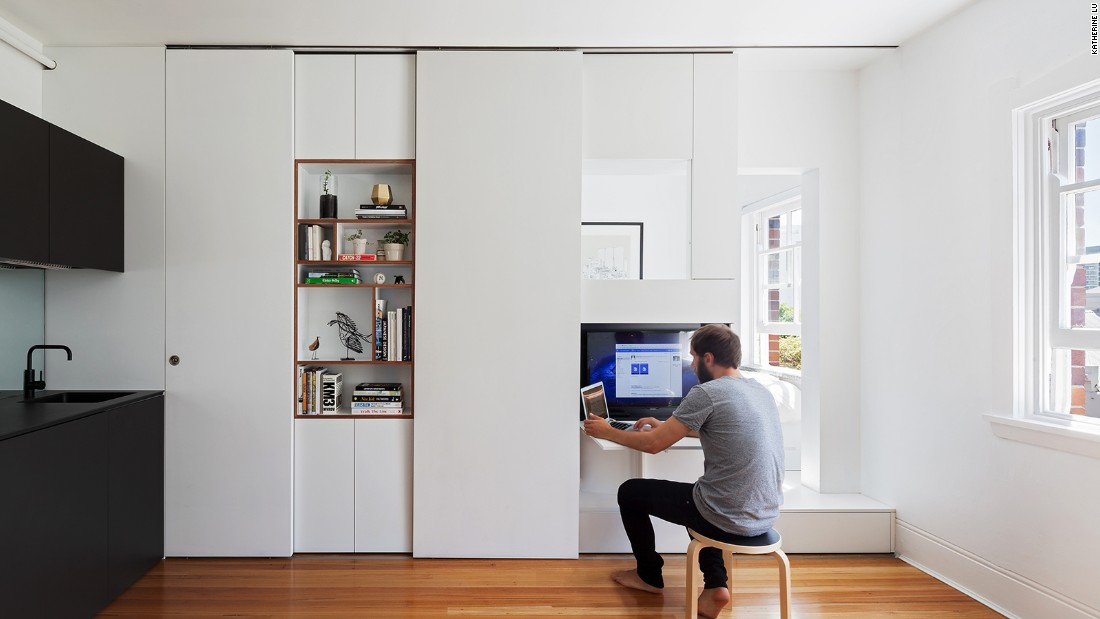 The white cupboards that encircle the bed, which the architects call Tetris pieces, were designed to provide maximum storage in a minimum of space.