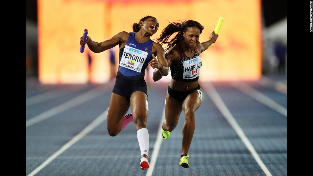 Ecuador's Angela Tenorio and Canada's Shaina Harrison cross the finish line during a 4x100 relay race in Nassau, Bahamas, on Sunday, April 23. Ecuador won this race.