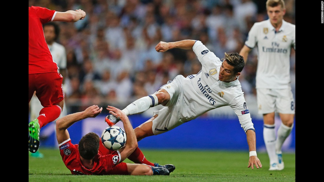 Real Madrid star Cristiano Ronaldo, right, competes for the ball with Bayern Munich's Xabi Alonso during a Champions League quarterfinal match on Tuesday, April 18. Ronaldo scored a hat trick in Madrid's 4-2 victory.