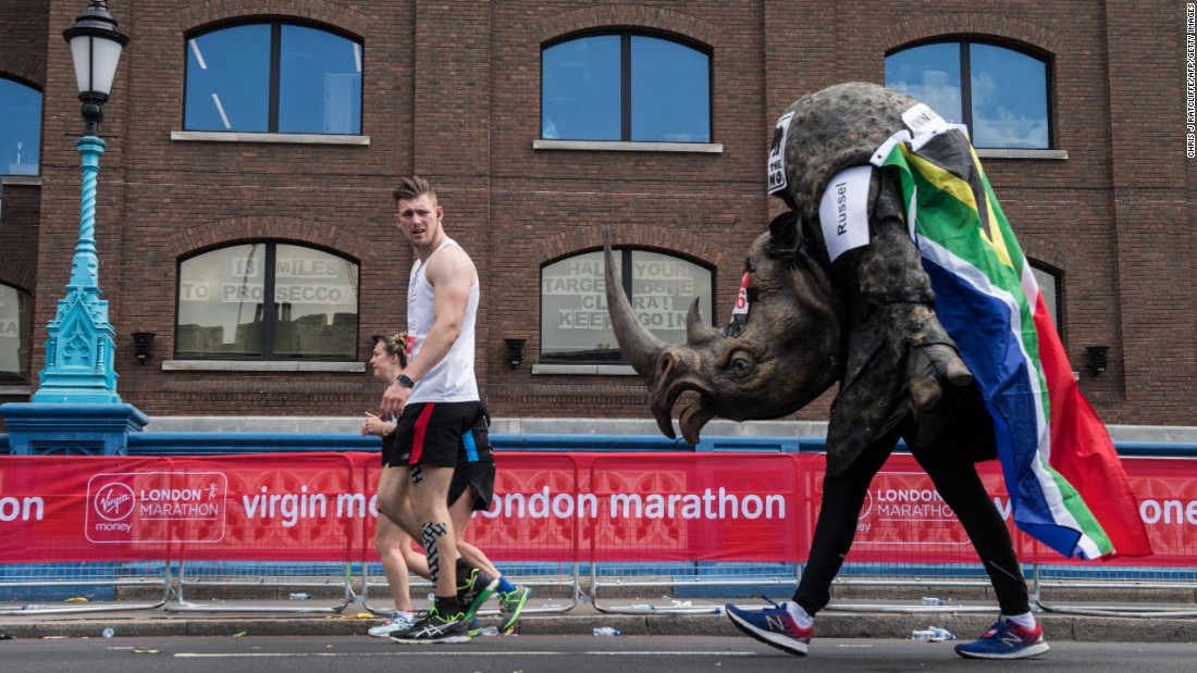 A runner dressed as a rhino takes part in the London Marathon on Sunday, April 23.