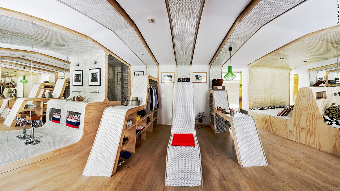 "Zooco Estudio transformed this 388-square-foot apartment as a tribute to Le Corbusier's Modular Man, according to ""Small Homes, Grand Living."""