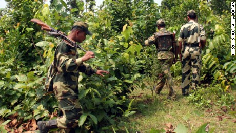 Indian paramilitary soldiers patrol inside a Maoist stronghold jungle close to West Bengal and Jharkhand bordering the village of Belpahari, some 150 kms. west of Kolkata, on April 8,2010. The massacre of 76 Indian policemen by Maoists on April 6, in the deadliest ever attack by the left-wing rebels could spark a military response that experts fear would only lead to more violence. The government has vowed to avenge the annihilation of a police platoon in Chhattisgarh state and for the first time hinted it may consider using the military against the increasingly lethal insurgency. AFP PHOTO/STR (Photo credit should read STR/AFP/Getty Images)
