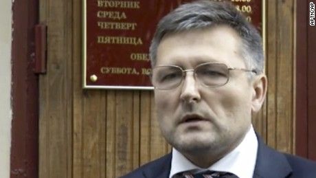 In this frame grab made from Sept. 13, 2012 AP video, lawyer Nikolai Govorkov leaves a court in Moscow, Russia. The lawyer hired by the family of Sergei Magnitsky, a Russian whistleblower who died in jail, has been injured in a fall from his Moscow apartment Tuesday, March 21, 2017. He is now in hospital with serious head injuries, according to a statement from William Browder, Magnitsky's former employer. (APTN photo via AP)