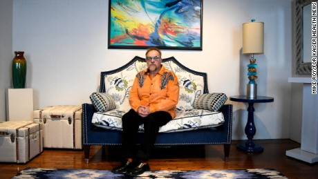 Michael J. Uvanni of Rome, N.Y., sits in one of his two interior design business showrooms in April 2017. Uvanni said his brother may have gotten more time from the many drugs he tried during his illness but that his quality of life was mostly terrible. (Mike Roy/for Kaiser Health News)
