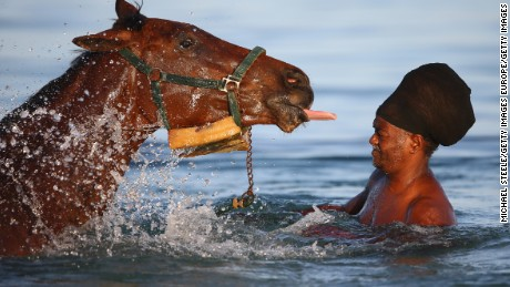 BRIDGETOWN, BARBADOS - MAY 02:  Race horses stabled at the nearby Garrison course are taken by grooms to the sea for aerobic exercise and recovery for foot weary and sore muscles.Trainers consider the aerobic exercise a break from trackwork and monotony of being confined to the stables and vital in the horses fitness preparation on May 2, 2015 in Bridgetown, Barbados.  (Photo by Michael Steele/Getty Images)