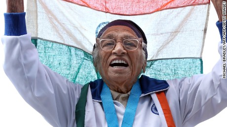 101-year-old Man Kaur from India celebrates after competing in the 100m sprint in the 100+ age category at the World Masters Games at Trusts Arena in Auckland