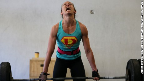"SAN ANSELMO, CA - MARCH 14:  Lita Collins does a deadlift during a CrossFit workout at Ross Valley CrossFit on March 14, 2014 in San Anselmo, California. CrossFit, a high intensity workout regimen that is a constantly varied mix of aerobic exercise, gymnastics and Olympic weight lifting, is one of the fastest growing fitness programs in the world. The grueling cult-like core strength and conditioning program is popular with firefighters, police officers, members of the military and professional athletes. Since its inception in 2000, the number of CrossFit affiliates, or ""boxes"" has skyrocketed to over 8,500 worldwide with more opening every year.  (Photo by Justin Sullivan/Getty Images)"