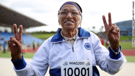 101-year-old Man Kaur from India celebrates after competing in the 100m sprint in the 100+ age category at the World Masters Games at Trusts Arena in Auckland on April 24, 2017. / AFP PHOTO / MICHAEL BRADLEY        (Photo credit should read MICHAEL BRADLEY/AFP/Getty Images)