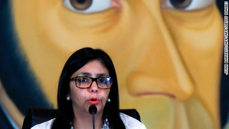 "Venezuelan Foreign Minister Delcy Rodriguez speaks during a press conference in Caracas on March 29, 2017.  Rodriguez accused on Wednesday the government of the United States of putting pressure on other OAS members to execute an ""interventionist plan"" in her country.  / AFP PHOTO / JUAN BARRETO        (Photo credit should read JUAN BARRETO/AFP/Getty Images)"