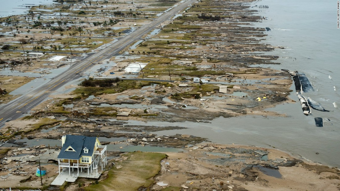 A single home is left standing amid debris from Hurricane Ike on September 14, 2008, in Gilchrist, Texas.